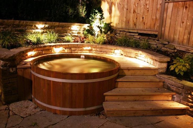 Idea Of Cedar Tub Partially Surrounded By Raised Deck Jacuzzi